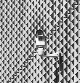 security-camera-on-patterned-building